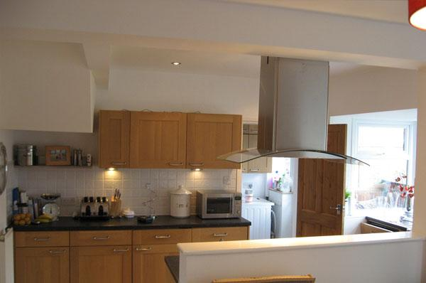 Inside a new built home by Harris Construction showing a fitted kitchen