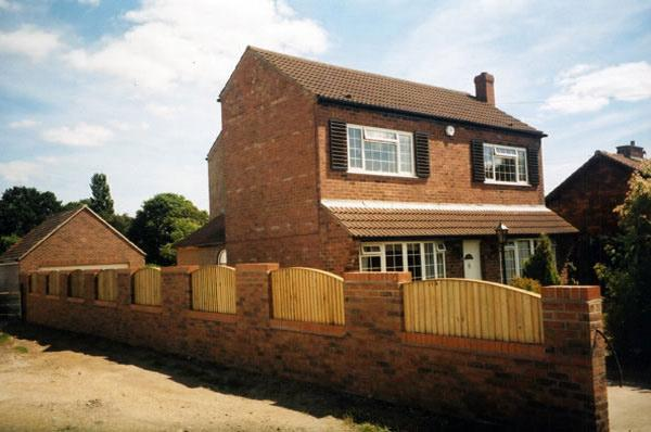 Newly built brick wall by Harris Construction