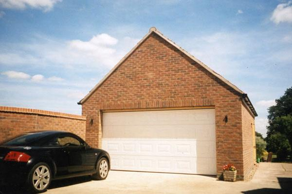 Newly built double garage with white door