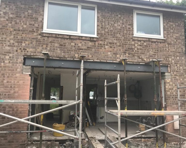 outside during house extension with patio doors knocked out
