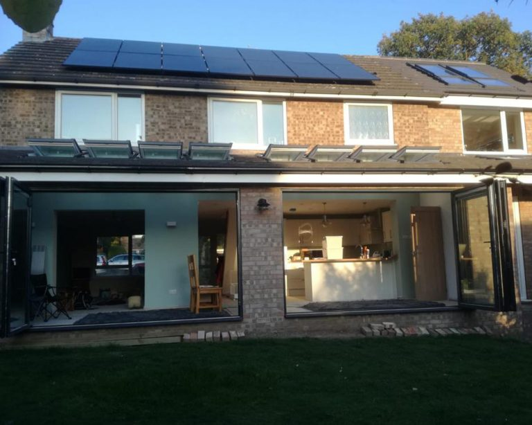 outside view of a newly built kitchen on a house extension showing the patio doors and velux windows