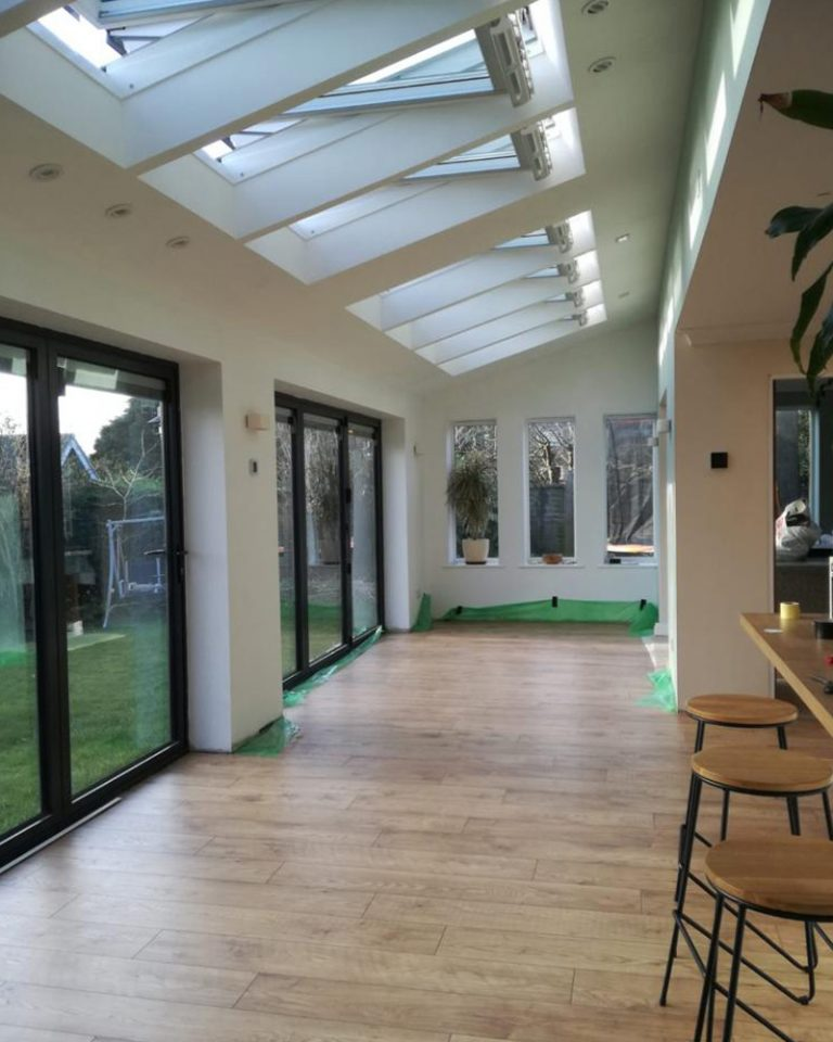 Inside a newly built kitchen on a house extension showing the patio doors and velux windows