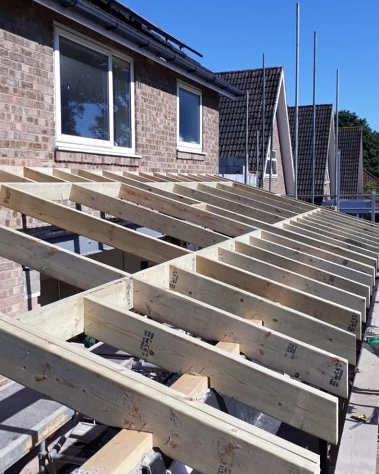 House extension showing the timber roofing trusses before the insulation and tiled are added