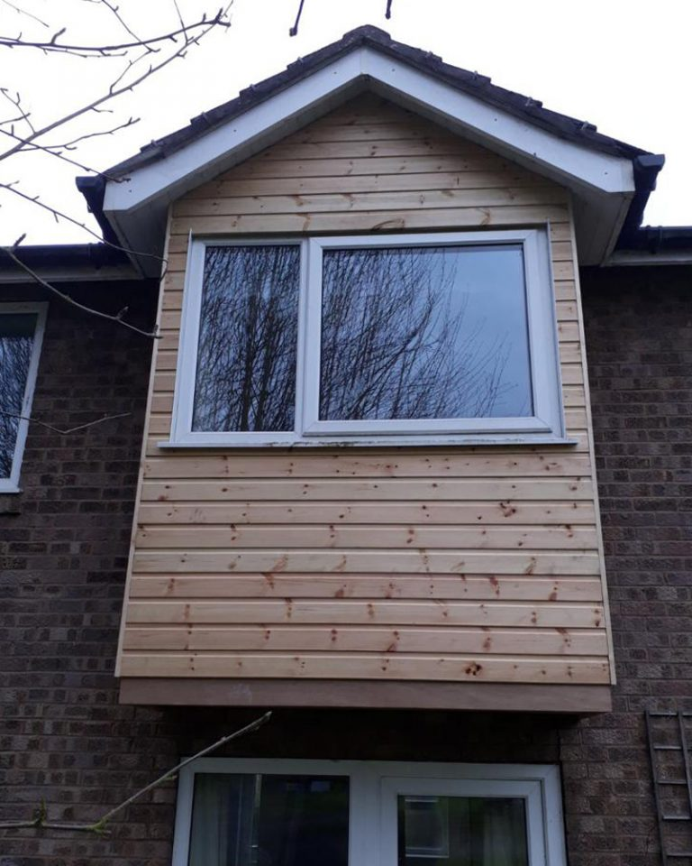 Insulations and timber cladding around a window during a House refurbishment in Fulford