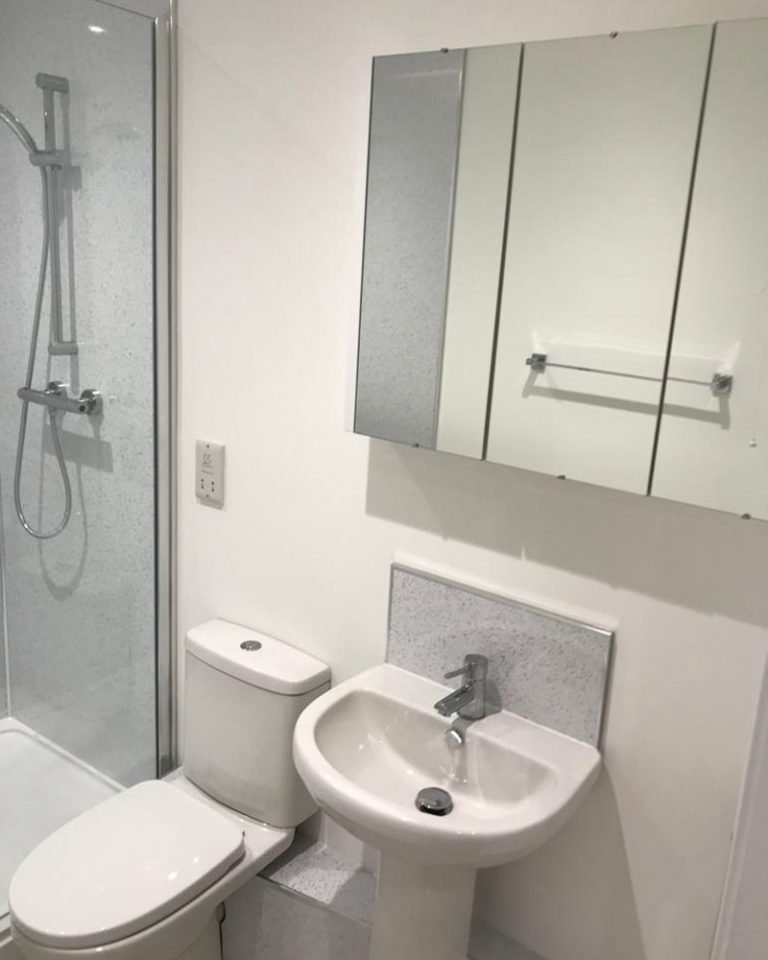 Inside a new built home by Harris Construction showing a bathroom and sink