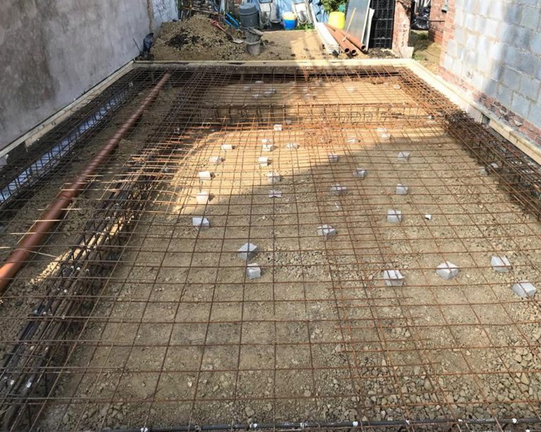 Foundations for a new build town house by Harris Construction showing the groundwork