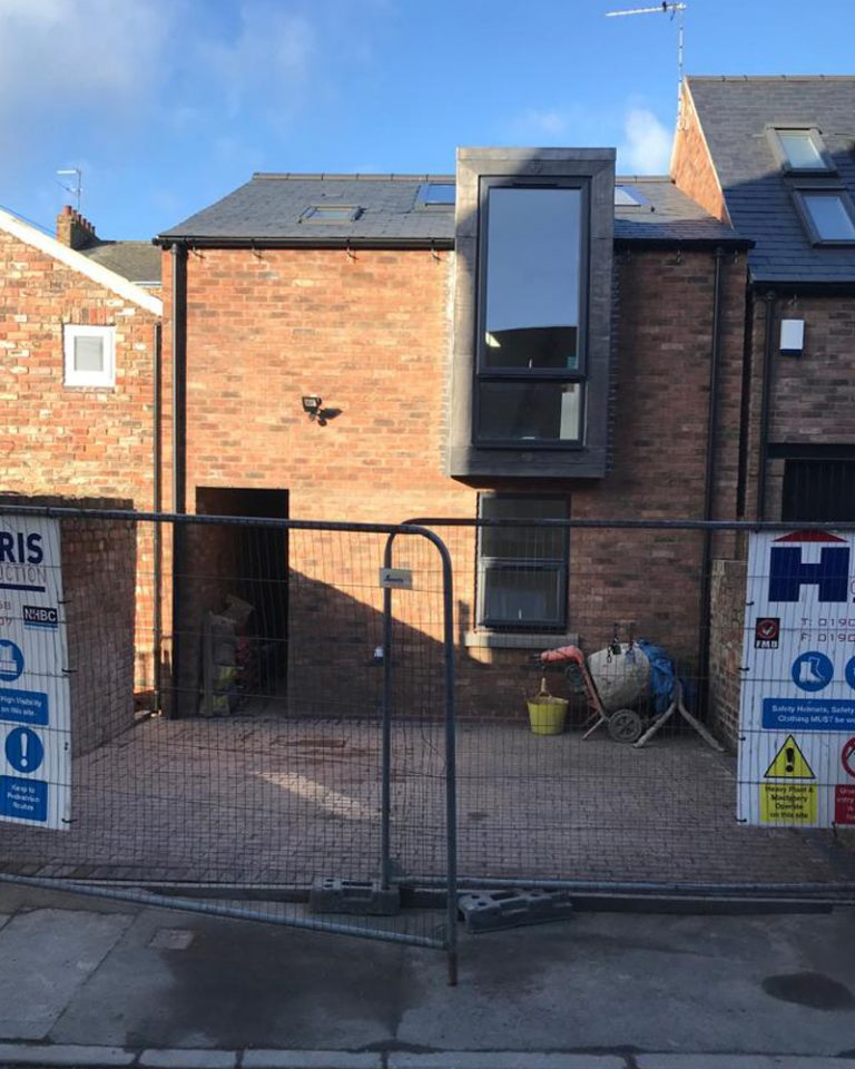Outside view of a newly built town house by Harris Construction