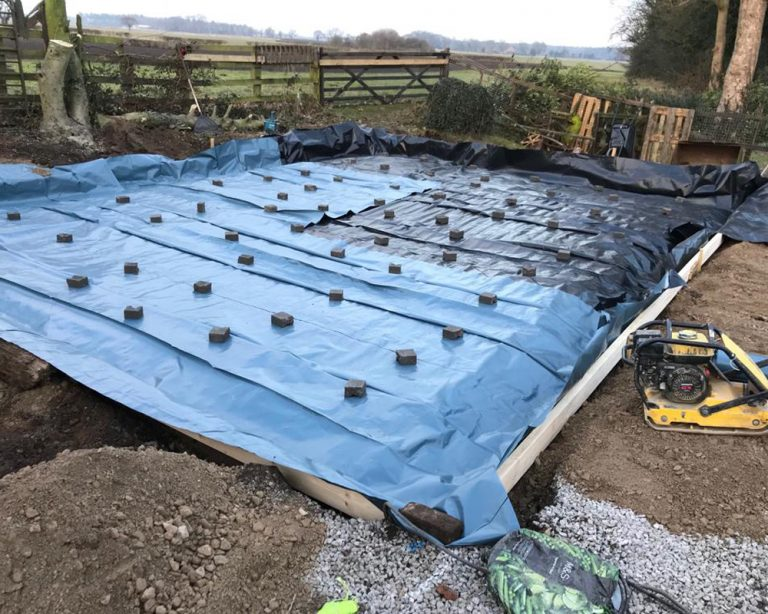 Ground work for a timber framed garage before the concrete based is applied concrete base
